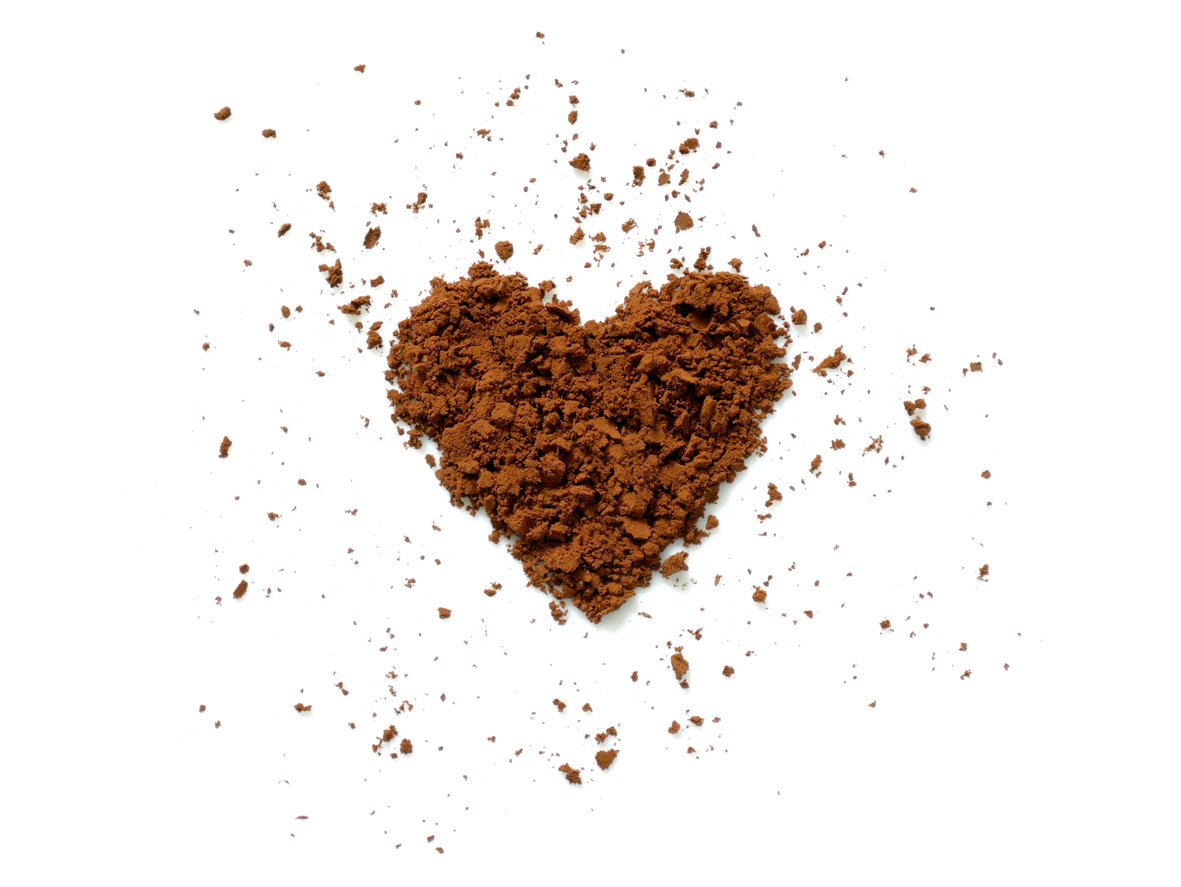 Cocoa powder spilling in heart shape